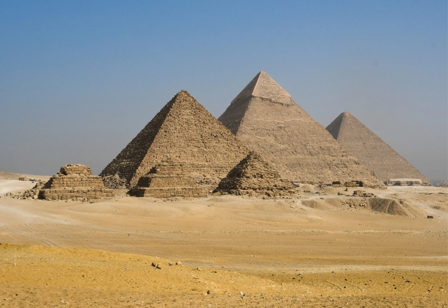 above The pyramids at Giza. Of the three large pyramids, that closest