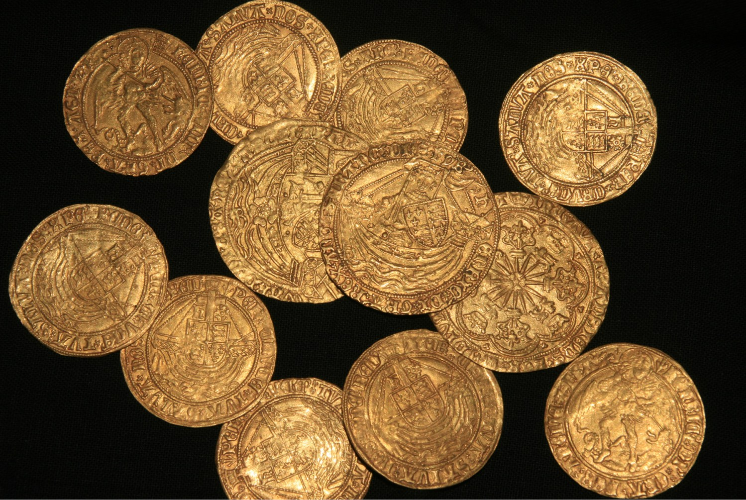 right The New Forest hoard includes various denominations, including a gold noble of Henry VI (shown in the centre); ryals of Edward IV (the large coins behind the noble); gold angels of Edward IV, Henry VII, and Henry VIII (the smaller coins); and four crowns of Henry VIII (see p.50).