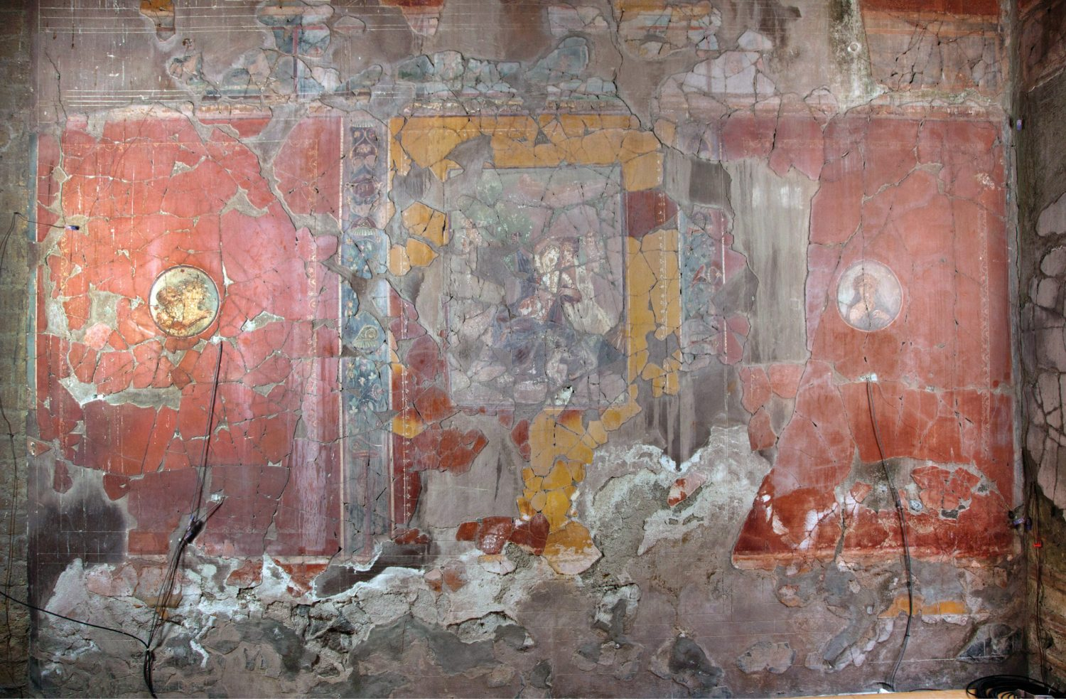 below From the 1980s, the House of the Bicentenary was closed to visitors due to structural issues and deferred maintenance. This led to severe deterioration of the wall paintings and mosaics. Salt activity from rising damp led to erosion and loss of paint along the base of the wall, and water infiltration from roof leaks left drips down the surface.