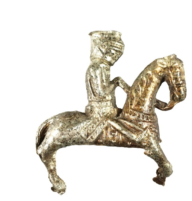 LEFT This carved wooden head dates to the medieval period, and might have belonged to a jester's marotte. ABOVE This pewter miniature knight on horseback, just 5.8cm high, was found in the so-called 'Bishop's garbage pile'.