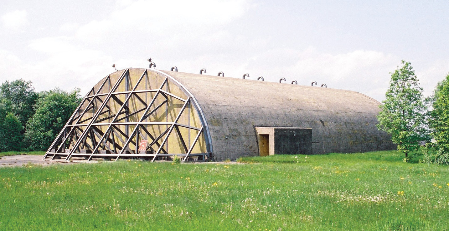 RIGHT A hardened aircraft shelter at Upper Heyford, Oxfordshire, 1980. Each of these buildings would house a fully armed F-111 fighter/bomber.