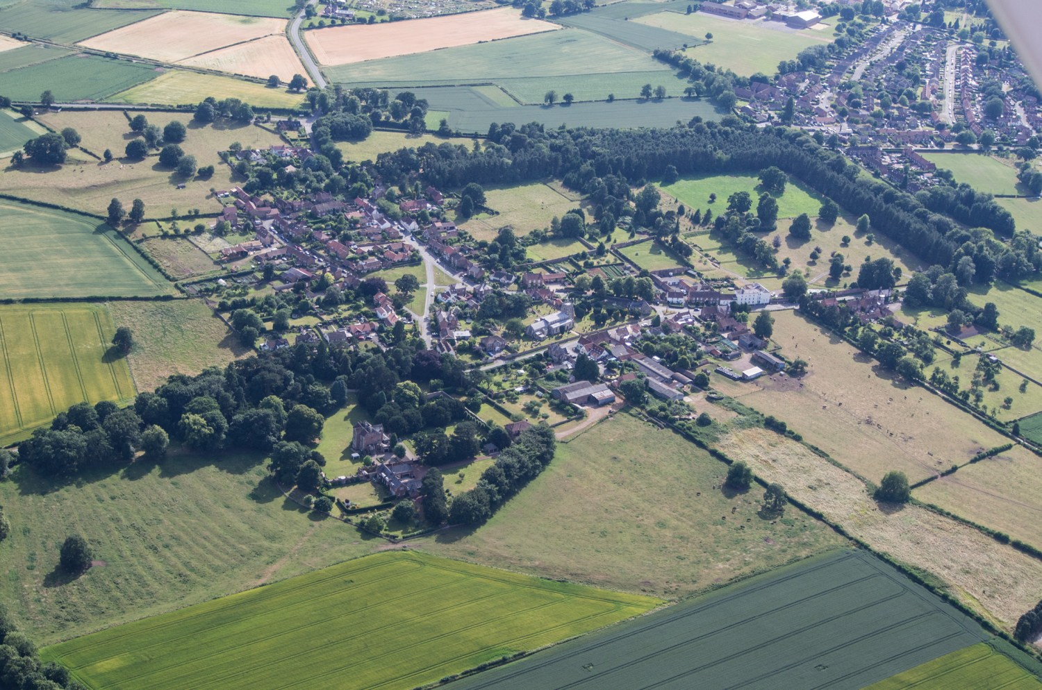 ABOVE Isurium never developed into a modern town; although the village of Aldborough covers the southern portion of the settlement, much of its northern extent lies beneath open fields. The village church, which can be seen in the centre of this photo, stands over the heart of the Roman forum.