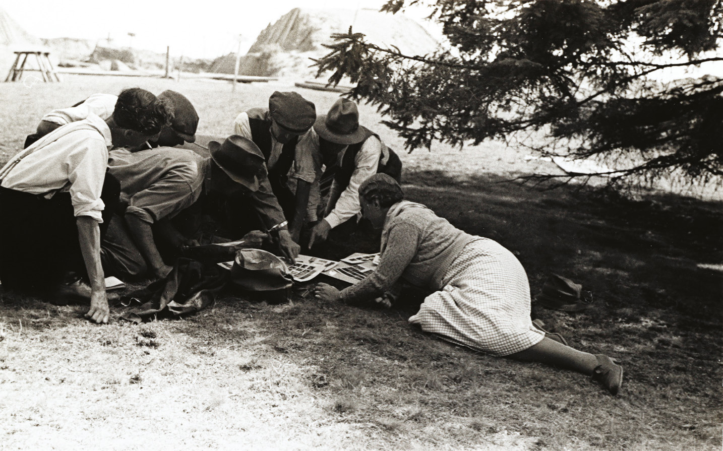 LEFT Mercie Lack and Barbara Wagstaff's images represent most of our photographic record of the 1939 Sutton Hoo excavation. Here, Barbara's photo shows Mercie with members of the dig team might she be showing them her and Barbara's work?