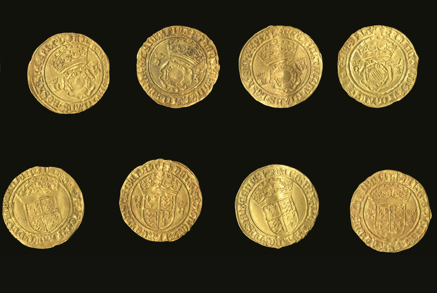 below Within the hoard are four gold crowns, issued by Henry VIII, which are marked with the king's initials and those of his first three wives: Catherine of Aragon, Anne Boleyn, and Jane Seymour.