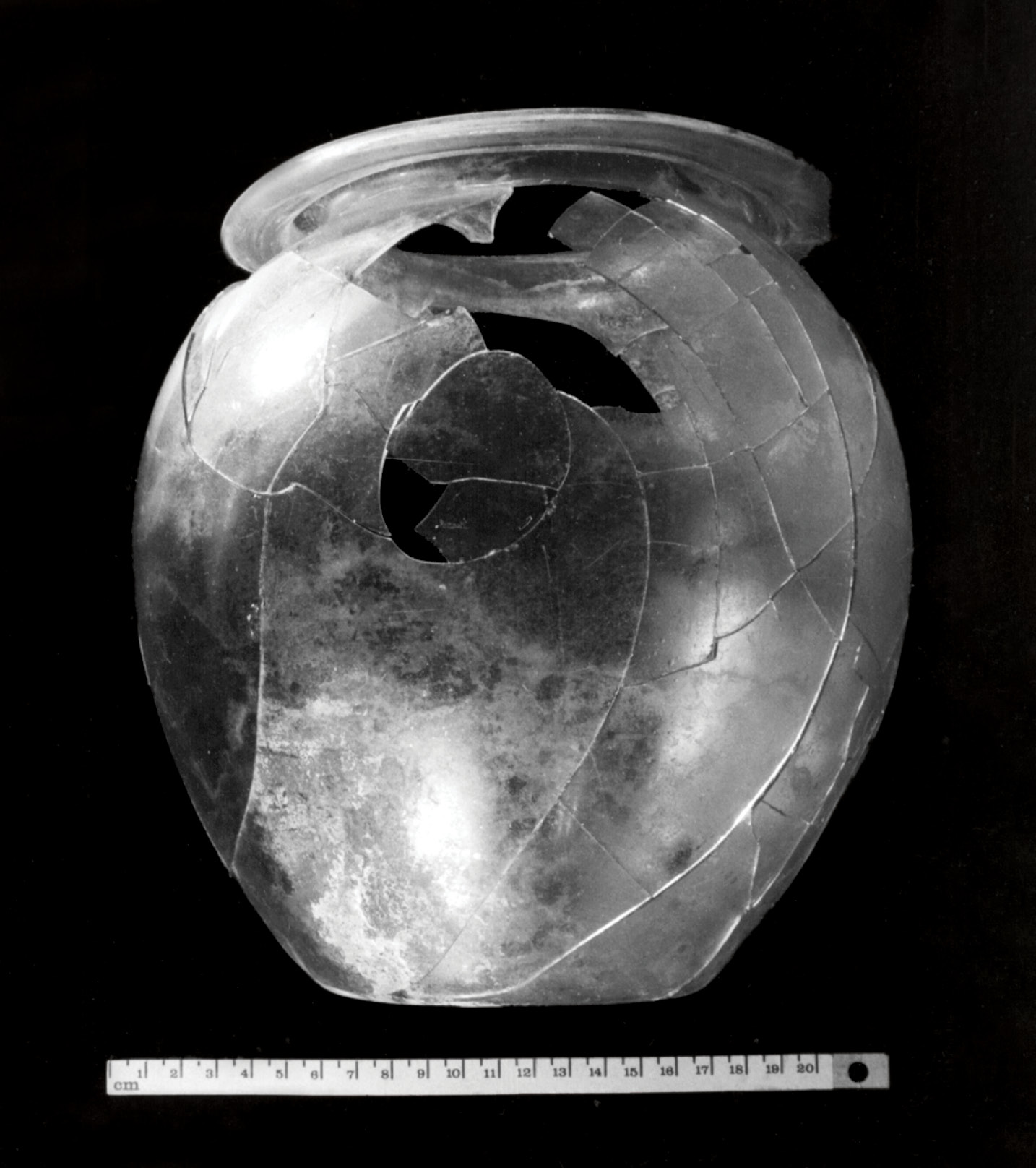ABOVE A rare example in Ireland of a Romano-British cremation jar, found at Stoneyford, Co. Kildare, in 1852. The jar contained cremated bone and a small glass lachrymatory (a bottle for holding the tears of the mourners). It was covered by a bronze mirror. The burial site, above a navigable river leading to the sea at Waterford, suggests that the deceased was involved in trade with Roman Britain.