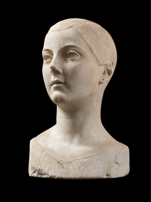 LEFT A girl's head, dating to roughly 50-40 BC. Once dismissed as modern, it was reputedly found at Vulci and is now regarded as a masterpiece from an Italic-Etruscan city. Holes in and above the girl's ear show where metal earrings and hair accessories once existed.