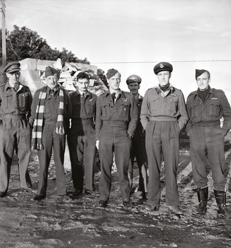 ABOVE Wing Commander Adrian Warburton (centre), Commanding Officer of No.69 Squadron RAF, with his crew in Malta during the Second World War. Alec Guinness played a loose version of 'Warby', who went missing over Germany in 1944.