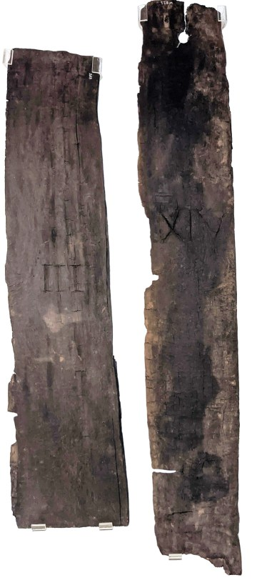 LEFT Parts of two wooden doors found in a barrack-block at Vindolanda, bearing the numbers III and XIV. They date to the first two decades of the 2nd century. BELOW One of the writing-tablets at Vindonissa recording a house number: 'For the custos armorum [keeper of the arms] in house number 30.' The number is indicated by 'XXX'