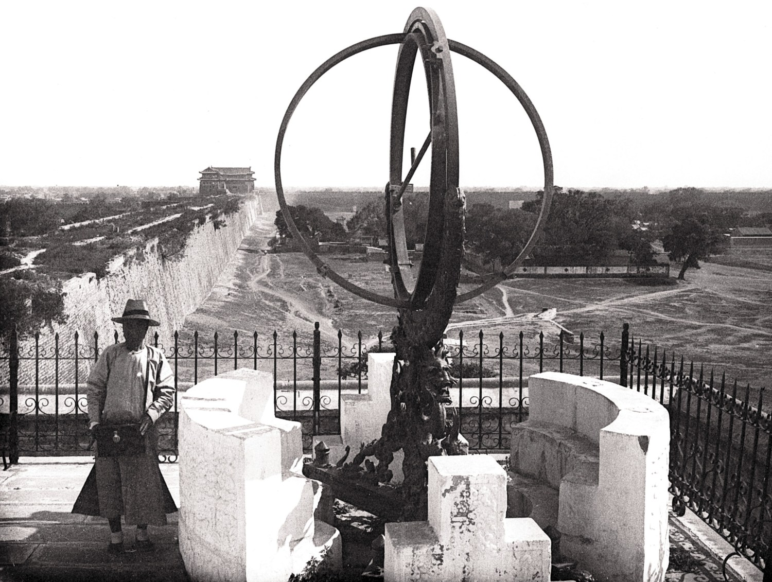 opposite Bi disc, Liangzhu culture, c.3300-2200 BC. Size: 38.8cm below Ferdinand Verbiest's 1673 armillary sphere in situ at the Beijing observatory. The photograph, from 1909, is by Joseph Rastoul.