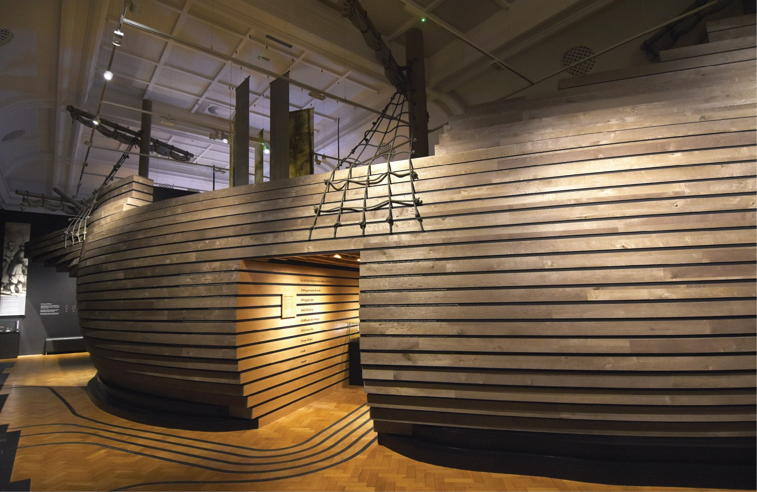 ABOVE Visitors can walk through the large ship structure that runs down the centre of the exhibition space to learn more about the journey and the