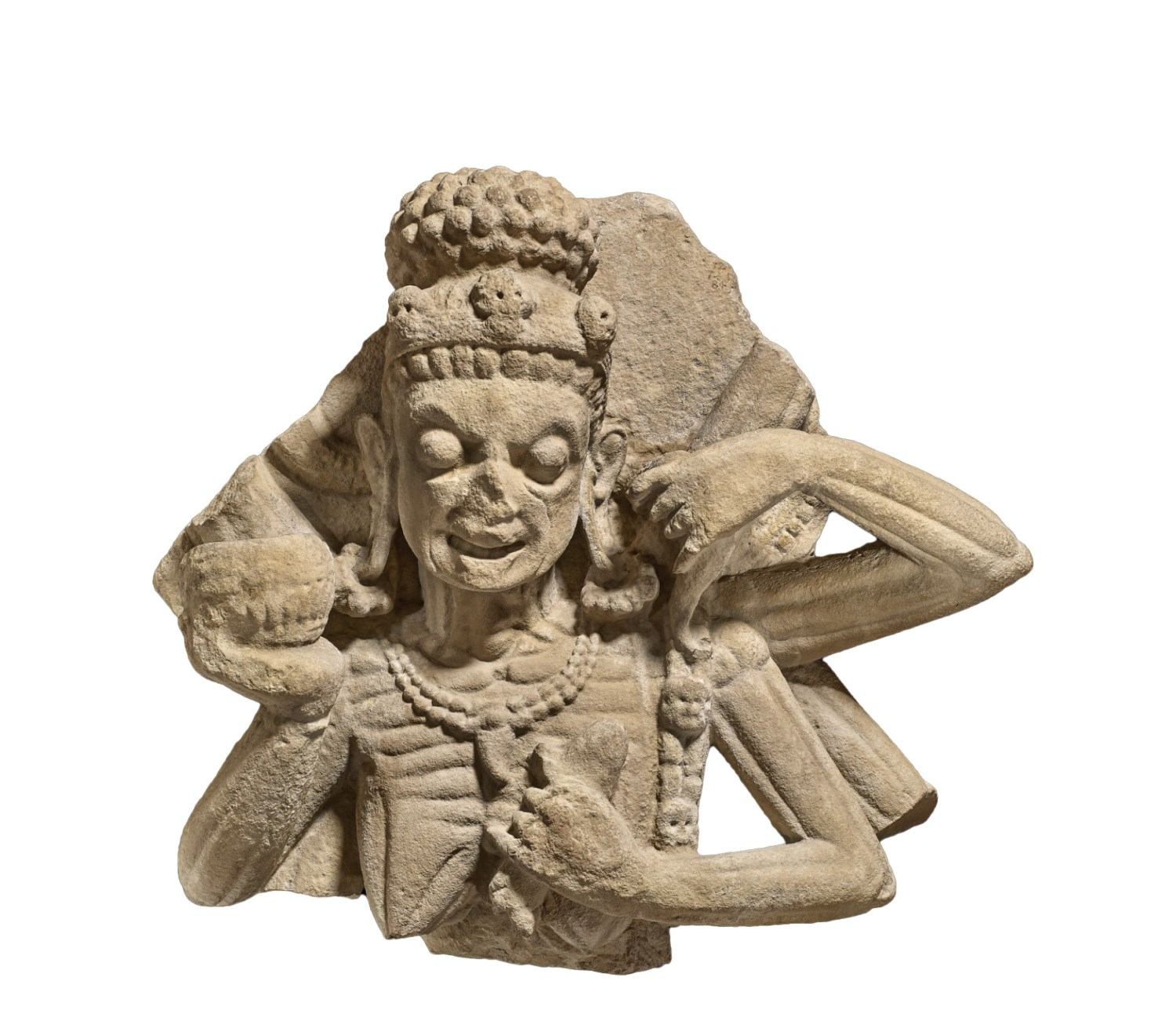 An 11th-century sculpture showing Chamunda, the leader of the Matrikas (ABOVE). Her bulging eyes, protruding bones, skull-adorned accessories, and the skull cup she brandishes create an unsettling composition. A more complete 9th-century rendering of Chamunda shows her dancing on a corpse (RIGHT), while the inhabitants of the cremation grounds she frequents watch on.