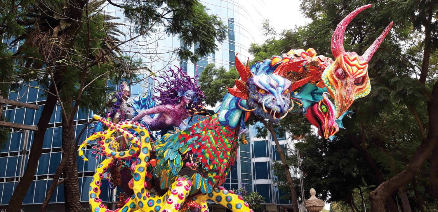 right Around 200 giant sculptures (mainly made from wood, chicken wire, and papier mâché) of alebrijes lined the route of the Day of the Dead parade in Mexico City. These bizarre hybrid creatures combine various real animals and beasts that only exist in the imagination. They were invented by the artist Pedro Linares (they came to him in a fever dream), but have since entered the folk-art repertoire we saw miniature ones being sold throughout our travels.