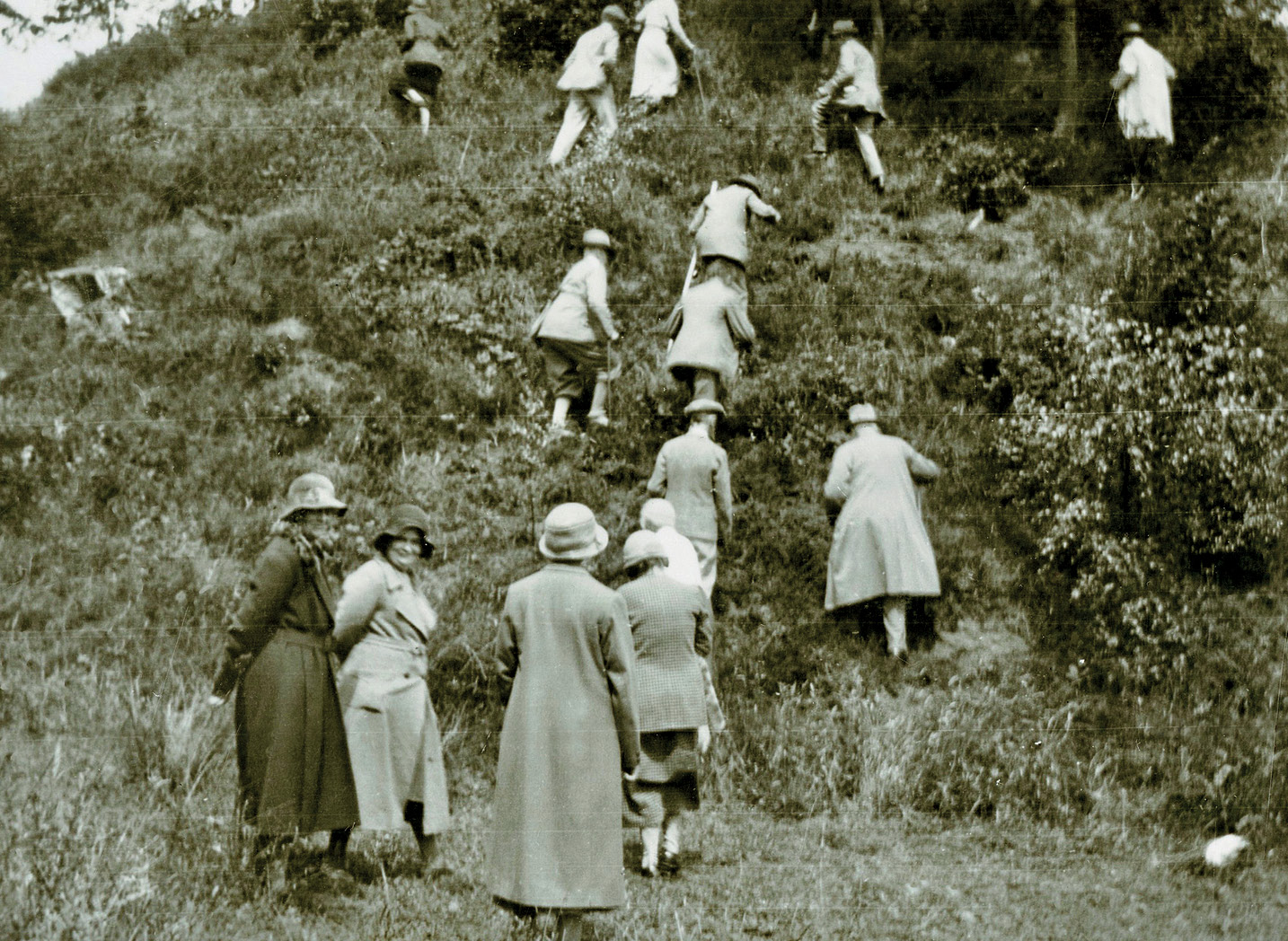 below Ley-line enthusiasts members of the Long Straight Track Club ascended the motte at Ponthendre in 1933 to investigate Alfred Watkins' claim that the mound was a prehistoric road surveyor's sighting platform.