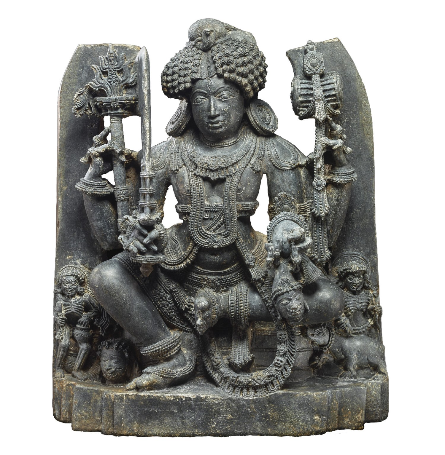 ABOVE An early example from Nepal of a 'Tantra' that is, a religious text. BELOW A 13th-century temple sculpture showing Bhairava. His impassive expression is undercut by the pair of fangs projecting from his mouth and the severed head clutched in his hand. Members of the demonic dead stand to Bhairava's left and right.