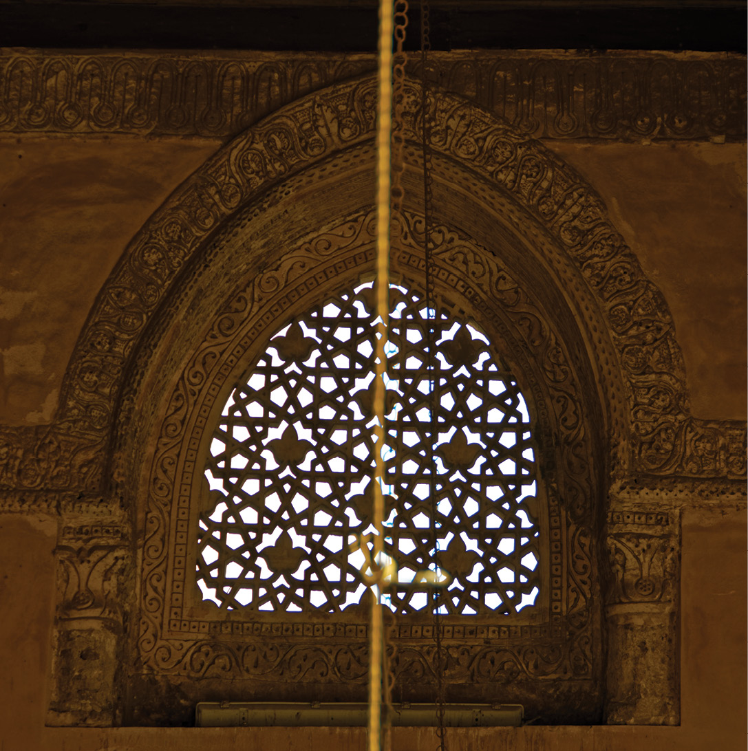 above Within the upper part of the walls of the mosque are 128 stucco grilles of different floral and geometric designs. Their placement is often off-centre when viewed from the court, which creates a curious sense of movement in the walls of the mosque.