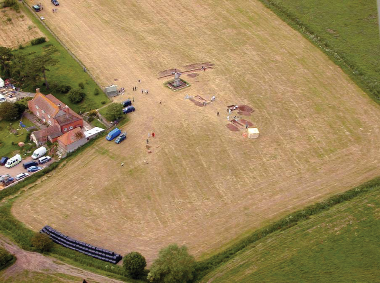 above Aerial view of the dig at Atheleny. King Alfred's monument, now closed to the public, appears at centre.