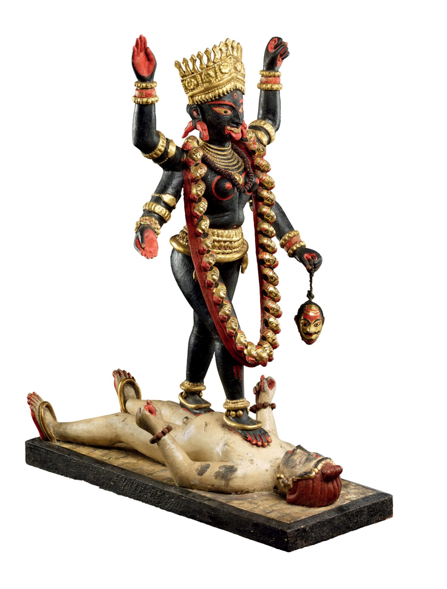 ABOVE A popular print of the goddess Kali, advertising cigarettes, published by the Calcutta Art Studio, c.1885-1895. Lithograph. Size: 42 x 32.1cm RIGHT Figure of the goddess Kali striding over Shiva, probably made in Krishnanagar, Bengal, 1890s. Painted and gilded clay. Size: 53 x