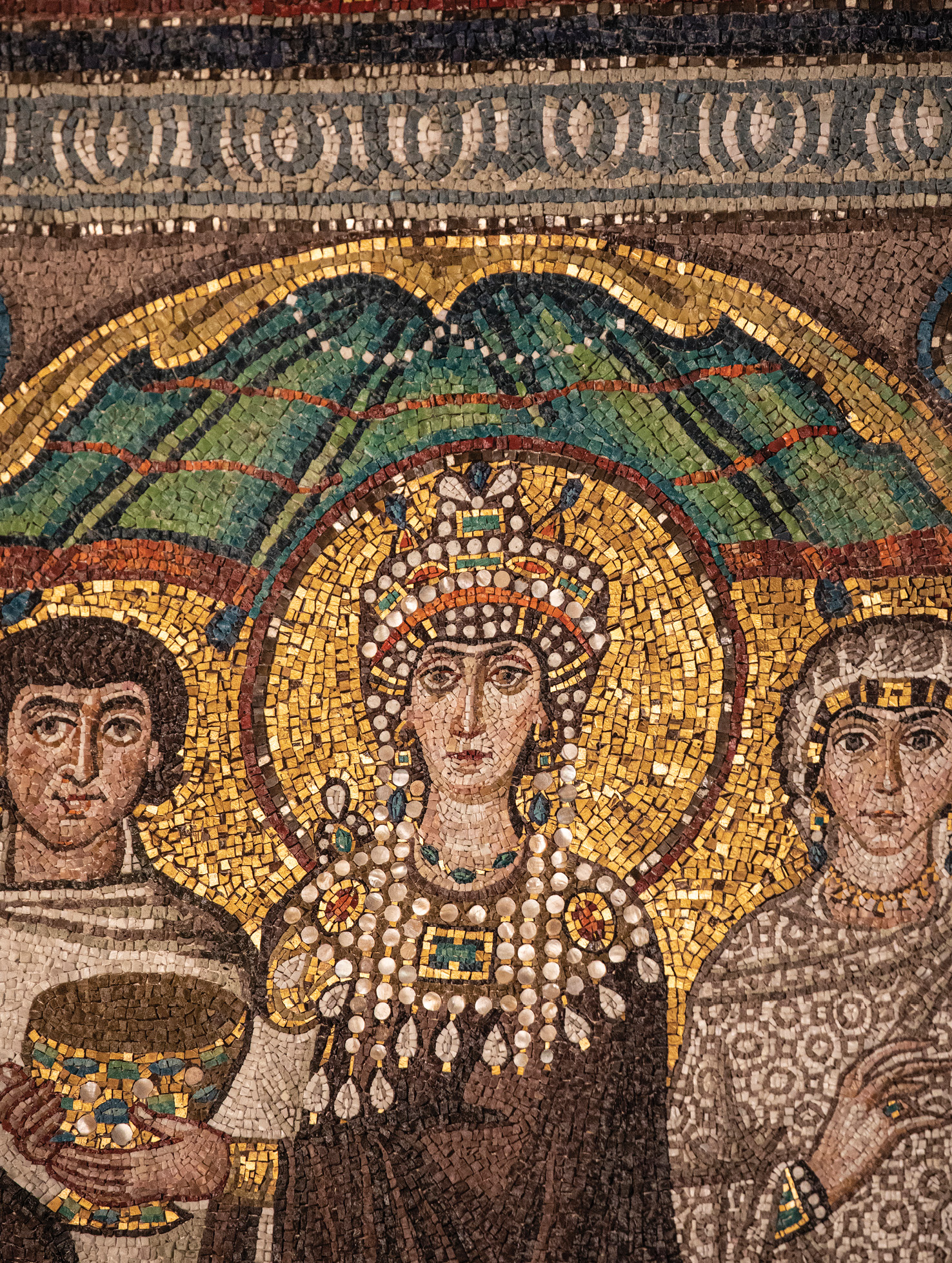 LEFT Empress Theodora (c.500-548), adorned with the trappings of imperial majesty, presents her gift of a chalice in this mosaic panel on the south wall of the presbytery of