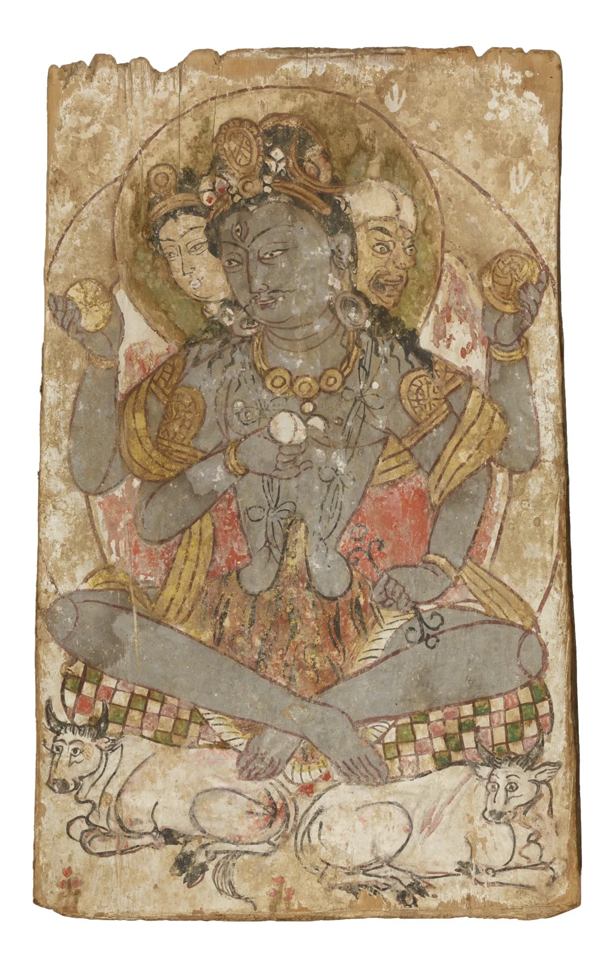 OPPOSITE A Mughal-style painting of a woman visiting two Nath yoginis, North India, c.1750. Gouache on paper. Size: 29 x 21cm ABOVE Votive panel depicting Shiva as Maheshvara, a protector deity in Tantric Buddhism, from Dandan Oilik in Khotan, north-west China, 7th-8th century. Painted wood. Size: 33.5 x 21x 2.5cm