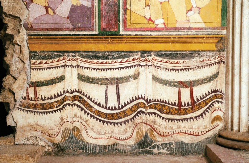 BELOW Colourful frescoes imitating wall-hangings within Brixia's 1st-century BC Republican sanctuary.
