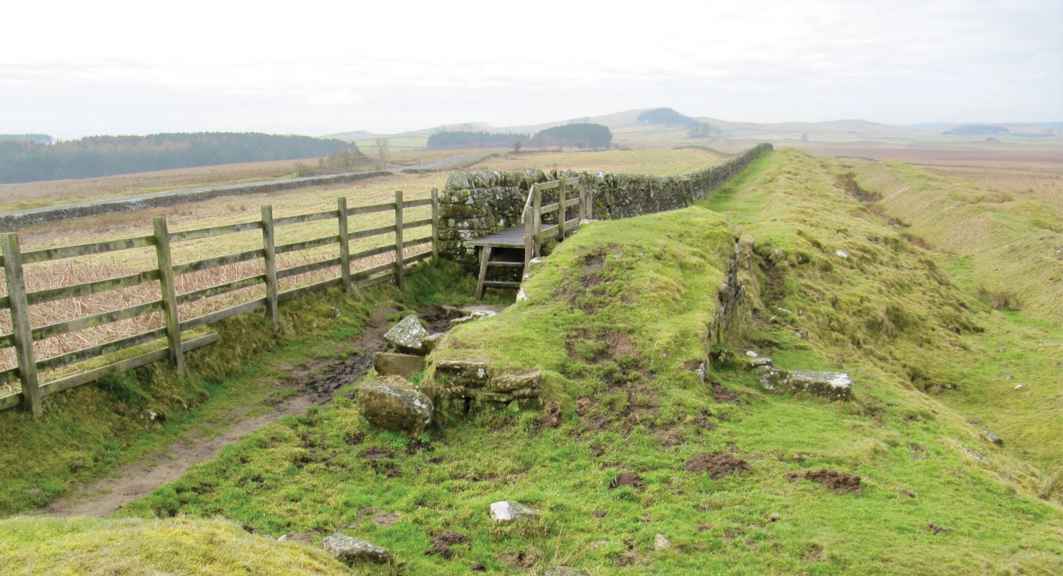 above A muddy 'pinch point' on the National Trail, within Milecastle 33, at the end of winter. The bridge carries the path over the side wall of the milecastle.