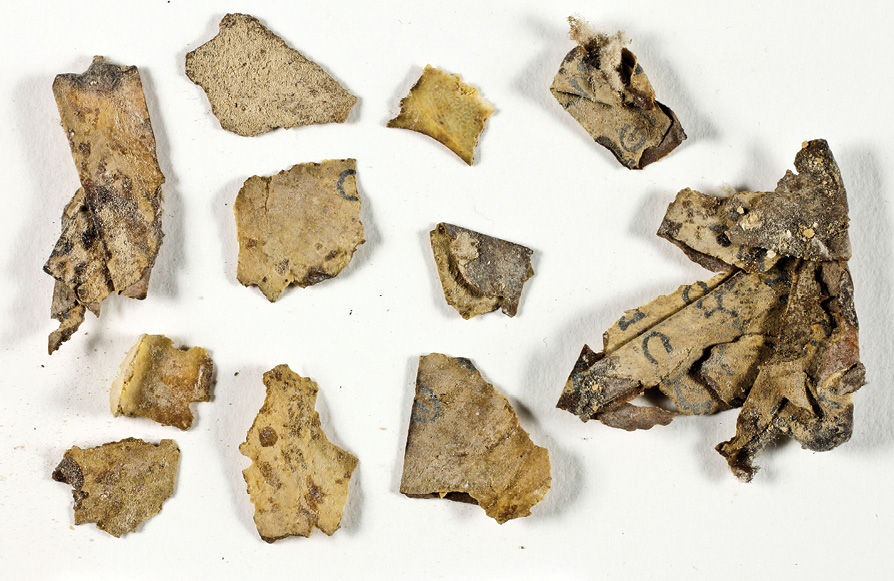 FAR LEFT New fragments of Dead Sea Scrolls and (LEFT) a 10,500-year-old basket were among the spectacular discoveries made in the caves of the Judean Desert.
