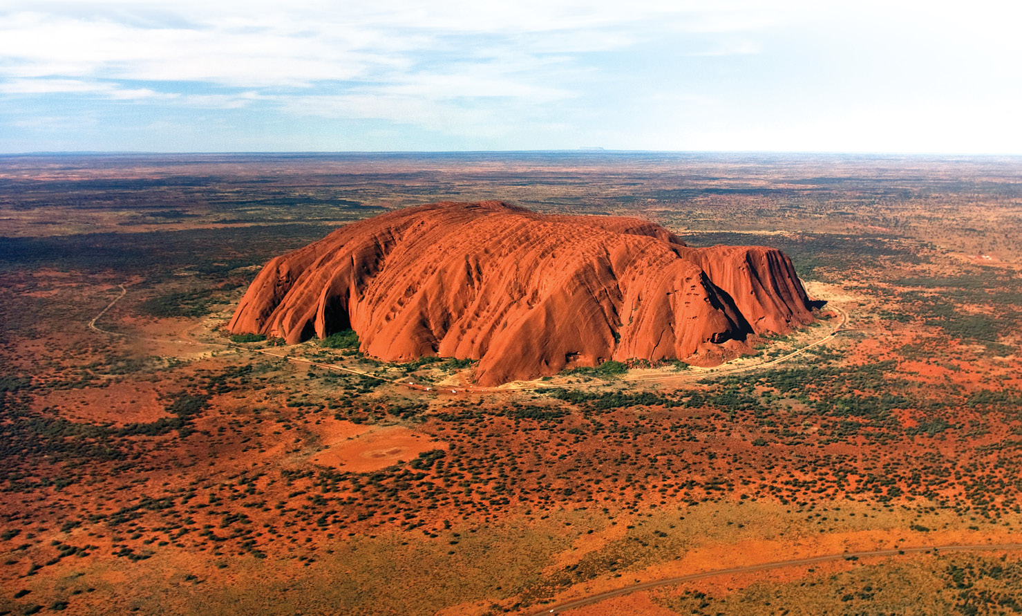 BELOW An official ban on climbing Uluru, which is a site of great spiritual significance for the Aboriginal people of Australia, was passed in 2017 and came into force in 2019.