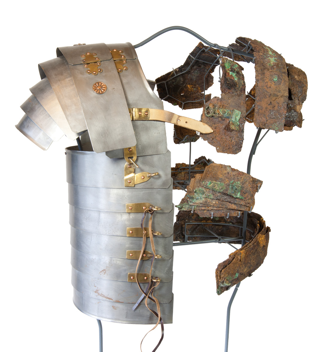 left Fragments of lorica segmentata armour from the Corbridge Hoard, mounted on a frame opposite half of a reconstructed suit.