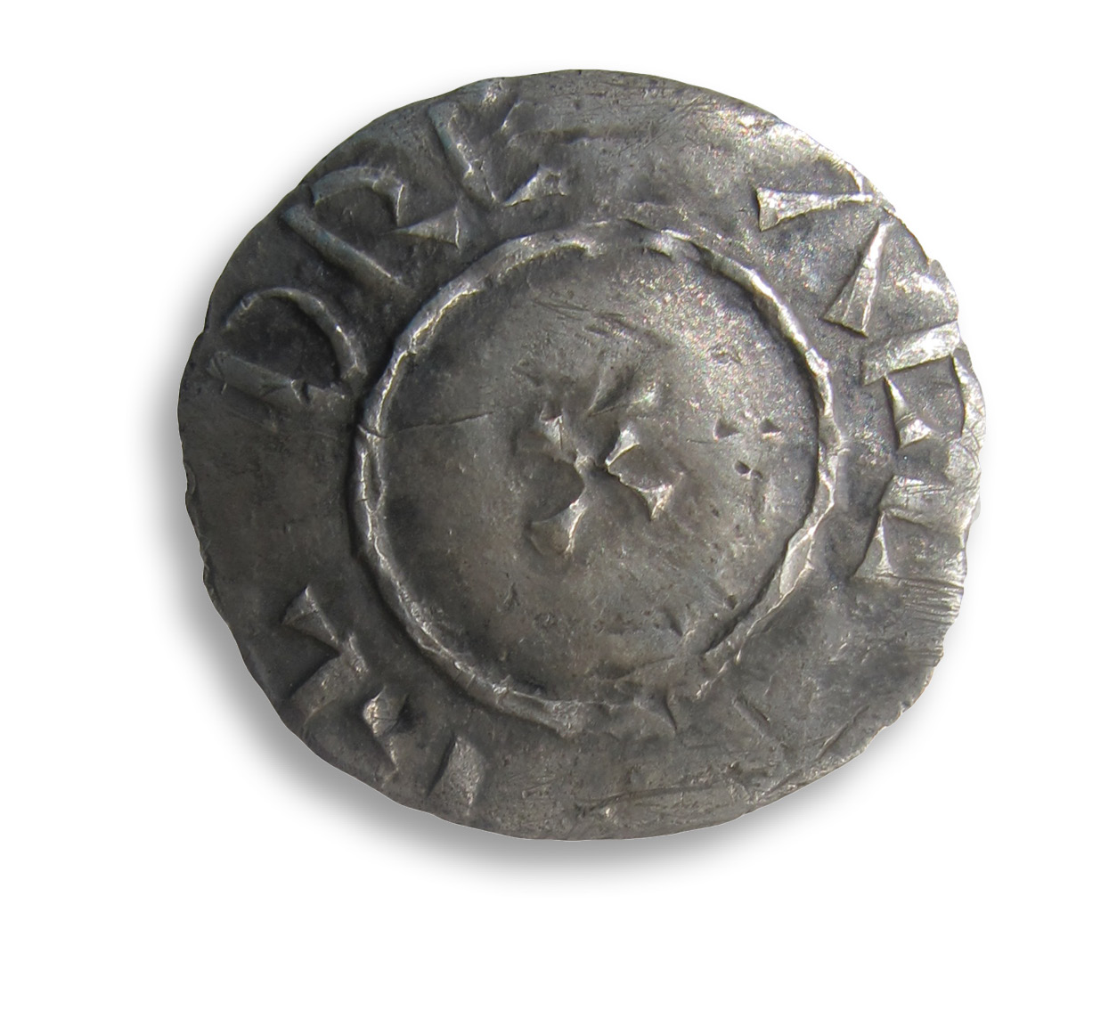 BELOW The latest coin in the hoard: this two-line-type penny of Alfred the Great provides a depositional date for the whole assemblage of c.AD 879.