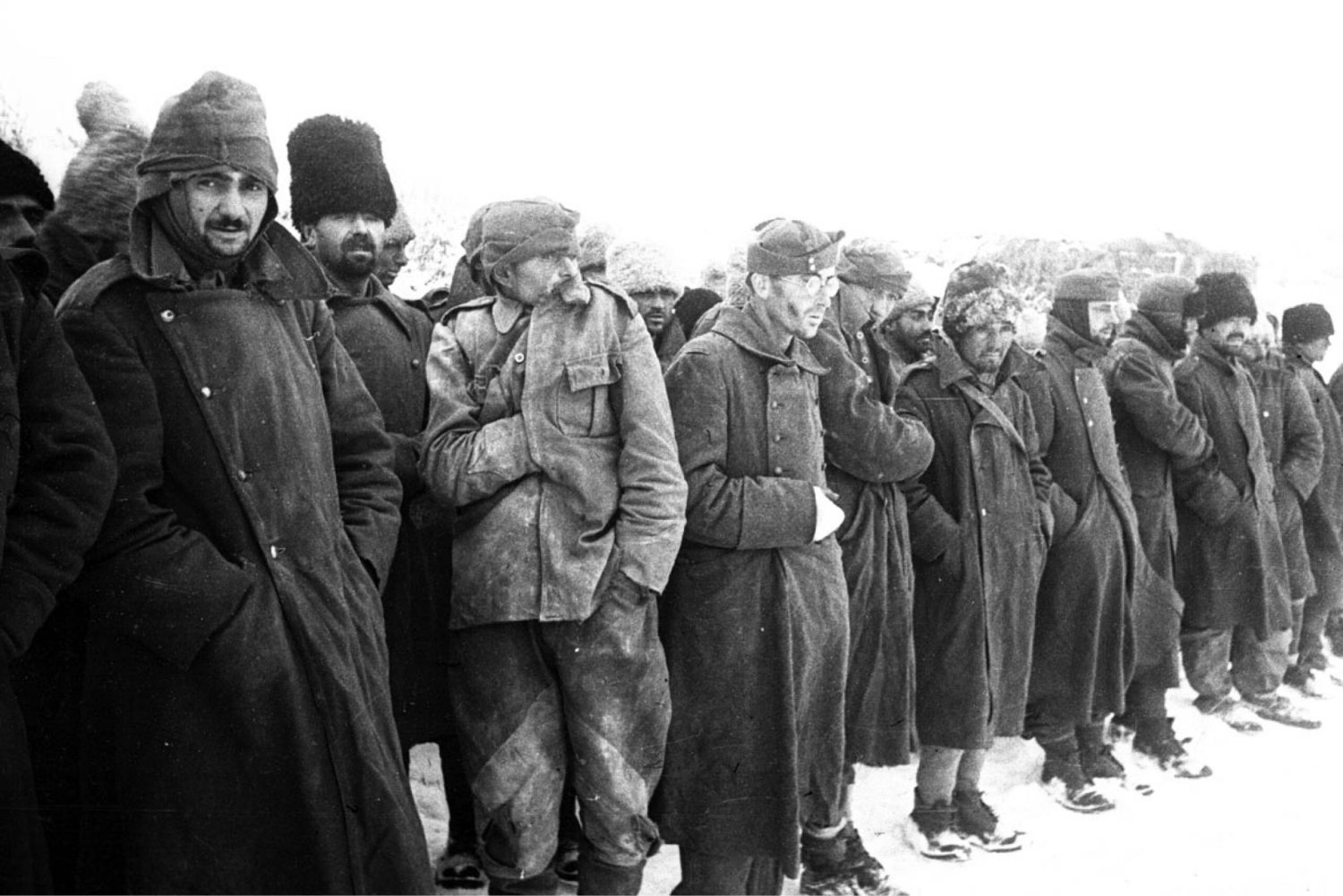 below Romanian prisoners at Stalingrad. opposite The Russian counter-offensive in southern Russia in winter 1942/43. The vast distances covered meant that the German armies became over-extended, with weak flanks, vulnerable supply-lines, and a lack of reserves. Marshal Zhukov's counter-offensive, launched in midwinter, struck at both flanks, which caved in, and allowed the Soviets to surround Stalingrad.