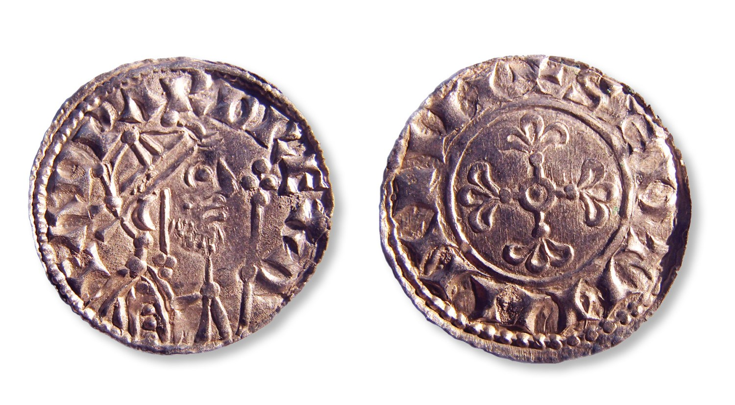 This coin is a 'mule', created using two dies from different coins one side shows a design from an issue of Edward the Confessor (right) and the other bears one of William I (far right).
