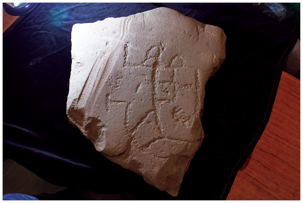 left The 3rd-century stone-footed strip building uncovered by the Settlement Project. It has been suggested that it may have been a house with a roadside shop at its front. above Incised on a stone slab close to the strip building, might this figure represent Cocidius, a local warrior deity?