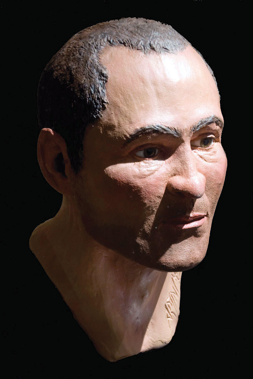right The face of a murder victim? This reconstruction is based on the remains of a Roman man who had apparently been beaten to death and his body thrown into a well.