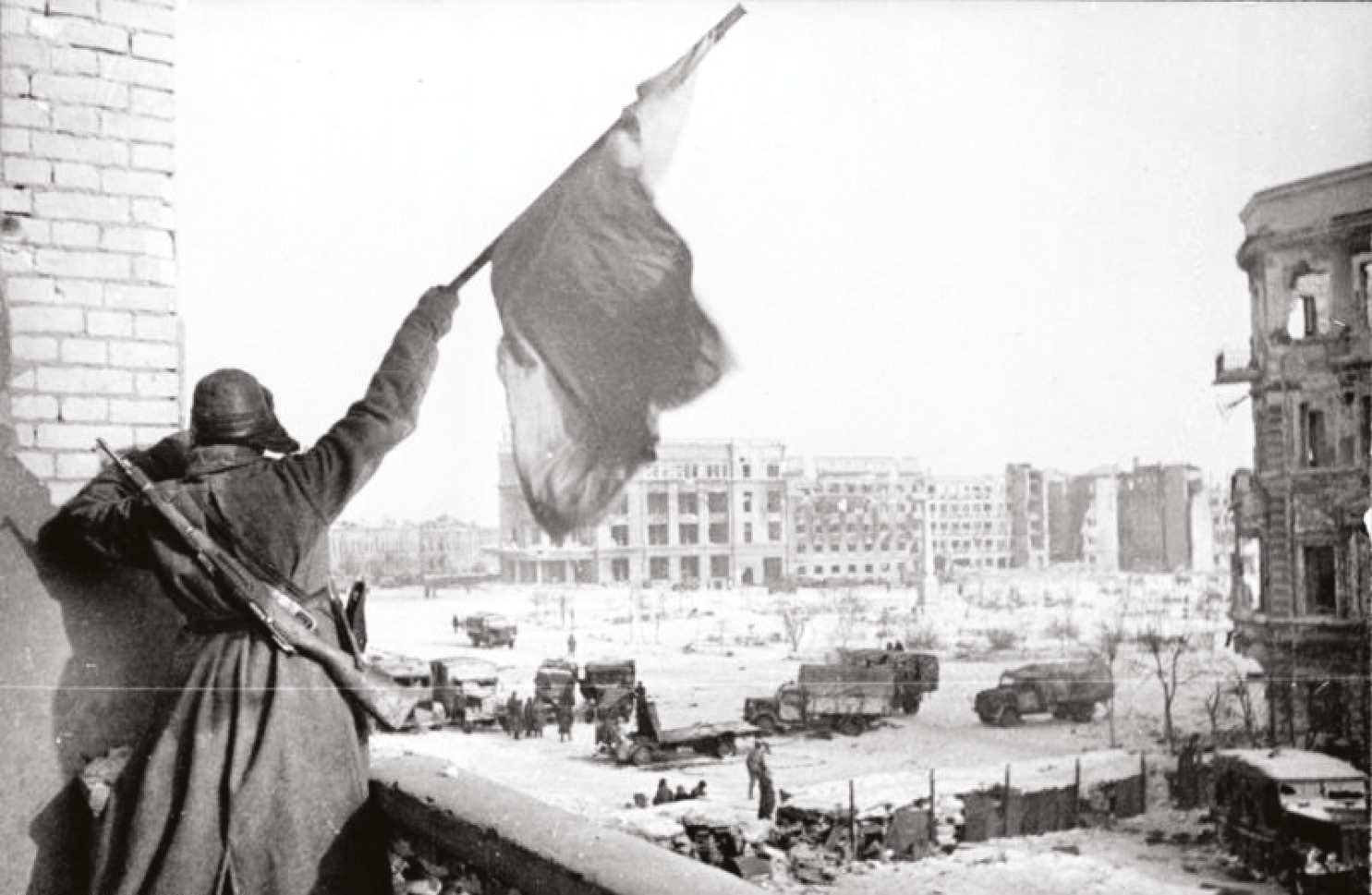 above Victory. A Soviet soldier waves the Red Flag over the ruins of Stalingrad.