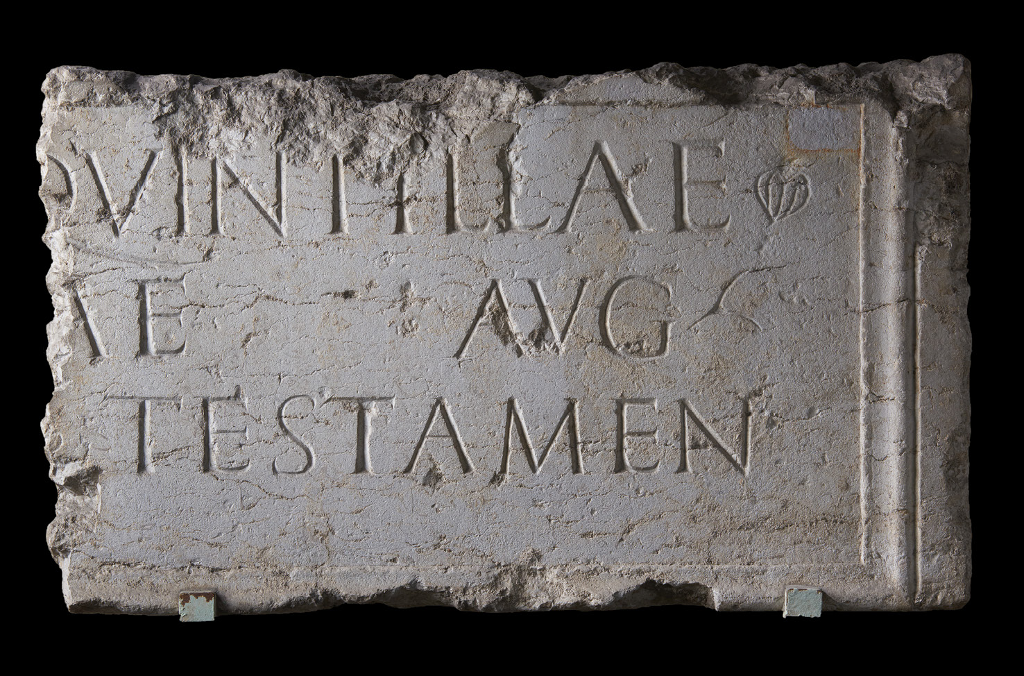 ABOVE A surviving fragment from an enormous inscription honouring Quintilla (named on the top line), and erected in accordance with her will (the testamen at the bottom). It demonstrates Quintilla's desire to be remembered as a flaminica Augustae.