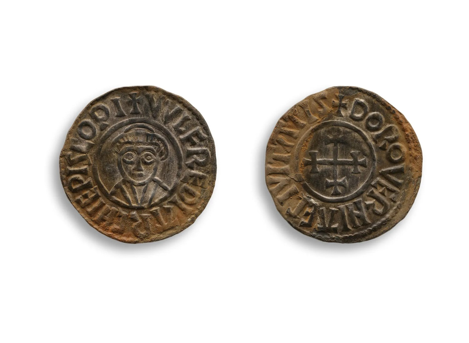 RIGHT This silver penny was issued by Wulfred, Archbishop of Canterbury, between 805 and 832; the other known Anglo-Saxon coins in the hoard were all minted in the name of Alfred the Great and Ceolwulf II, 9th-century rulers of Wessex and Mercia.