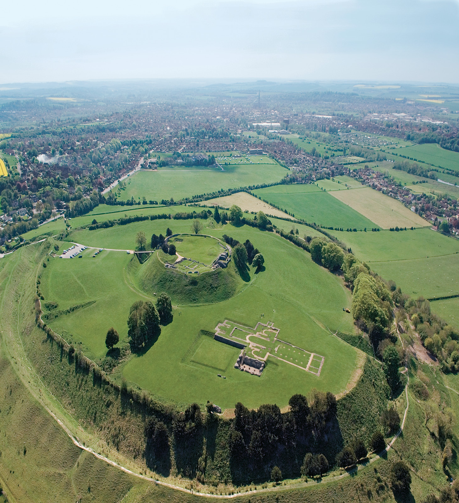above Old Sarum. The now demolished great tower stood on top of the massive earthworks of the earlier Norman motte, which itself occupies an Iron Age hillfort, standing alongside the ruins of the