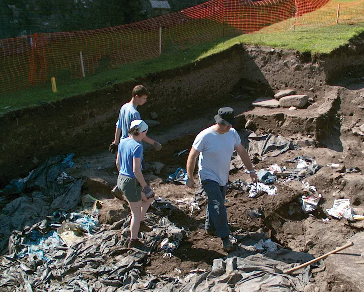 Below The Hope-Taylor main trench on the day of the unveiling, still covered with tarpaulins.