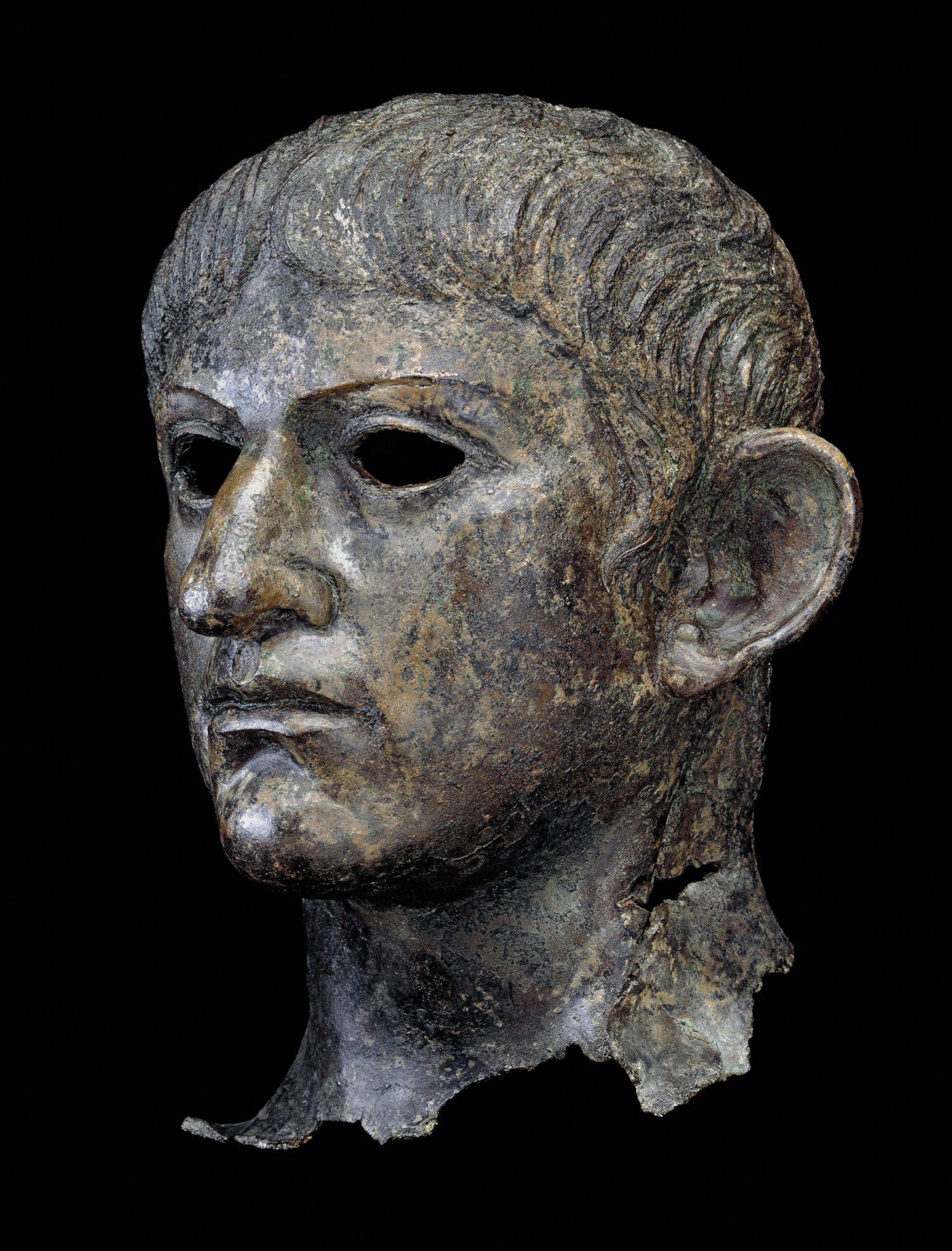 right Head from a bronze statue of the emperor Nero, found in the River Alde in England, AD 54-61. Size: 31.5 x 24.5cm