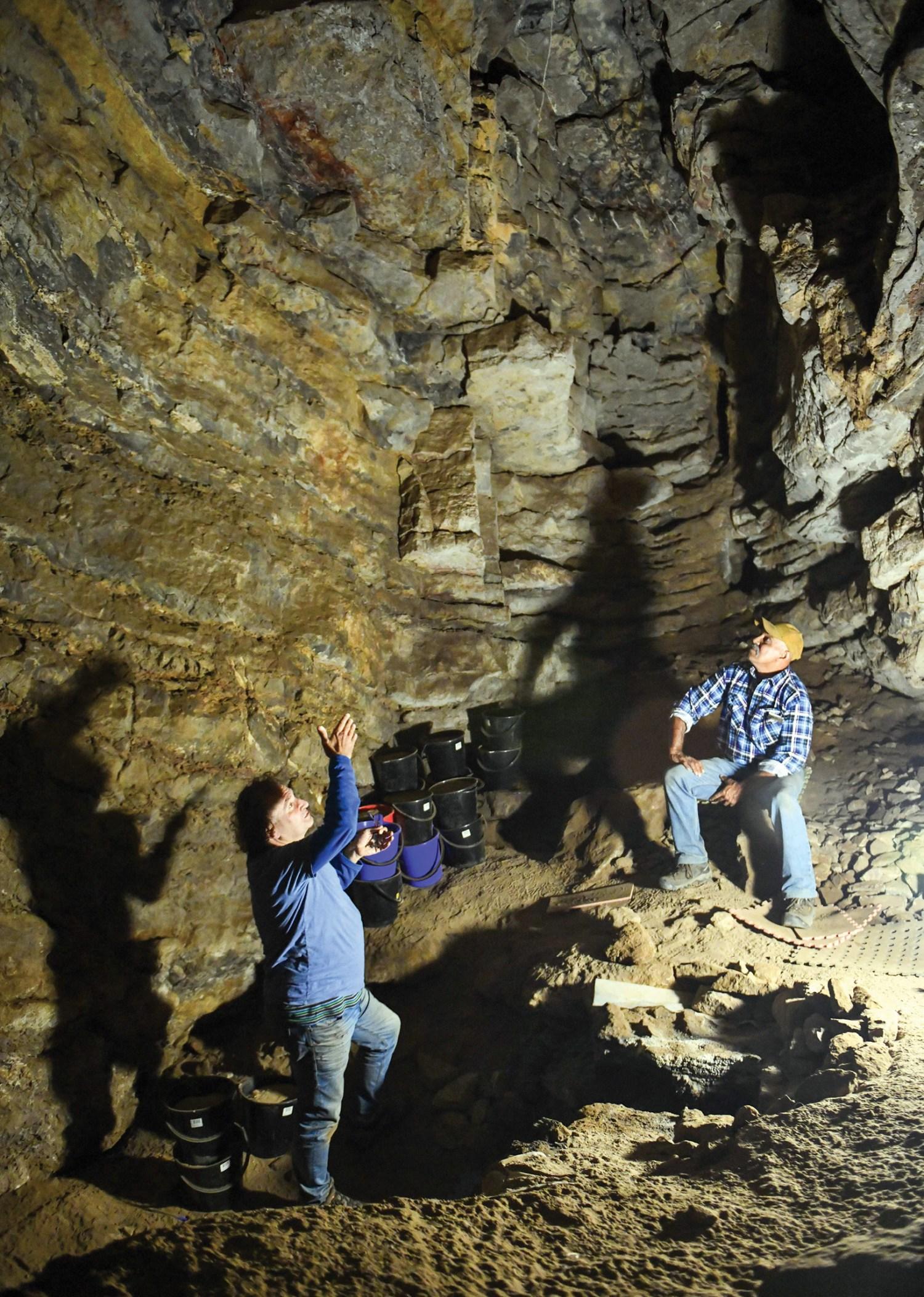 left Prof. Bruno David (on the left) and GunaiKurnai Elder Russell Mullett (right) inside Cloggs Cave.