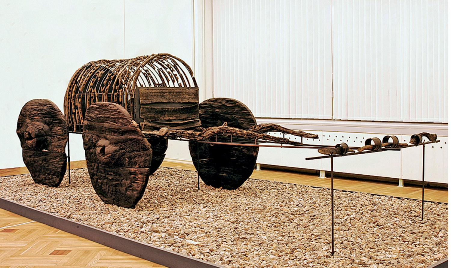 left A wooden funeral cart found at Lchashen. inset A bronze model of a fighting chariot.