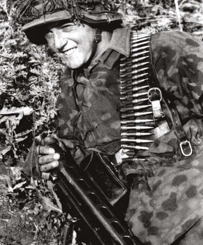 ABOVE LEFT Waffen SS man advancing with the infamous 'Spandau', the fast-firing MG42 light machine-gun.