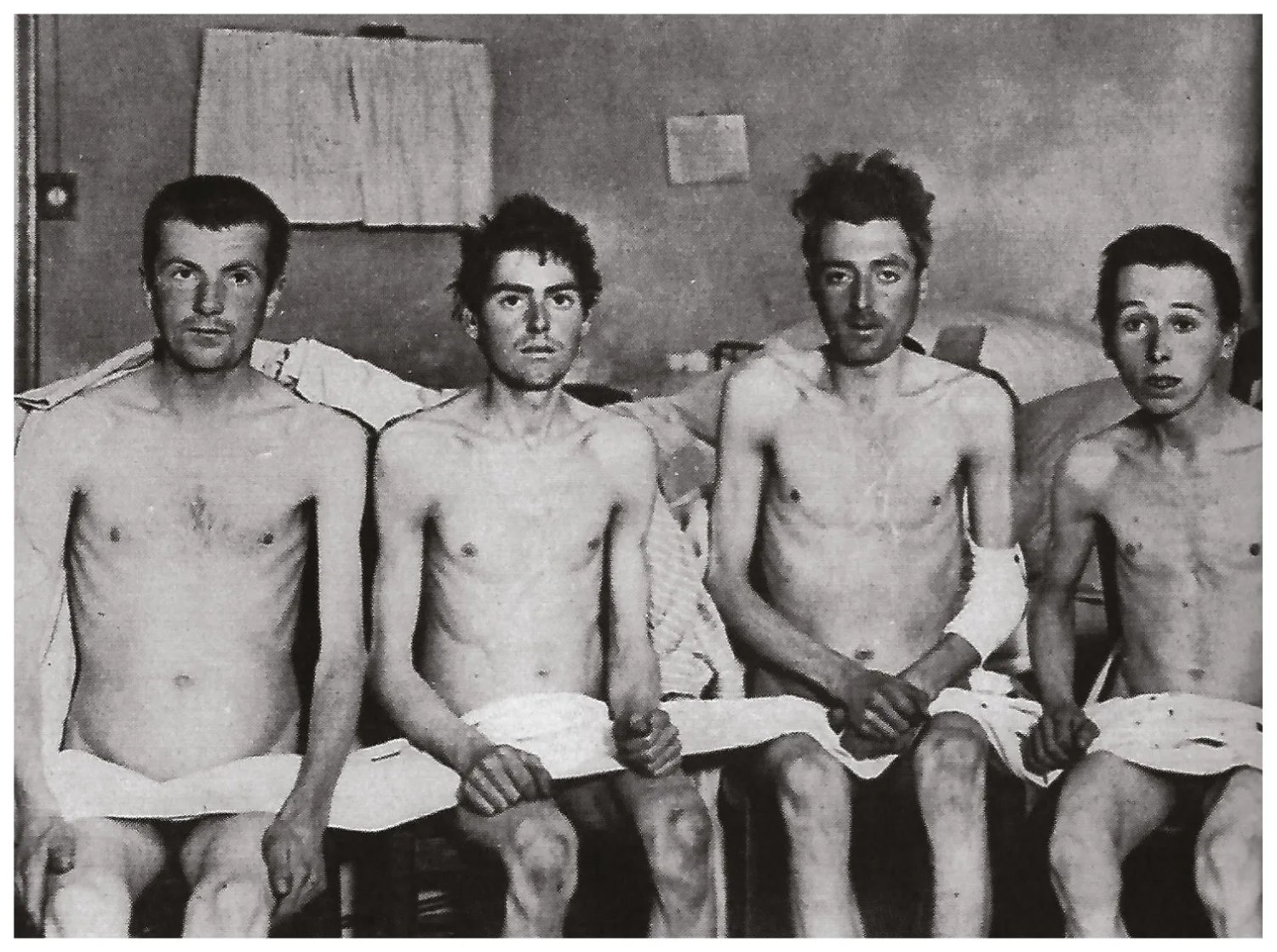 BELOW Malnourished and disease-ridden but alive. A group of former British POWs photographed after release at the Armistice.