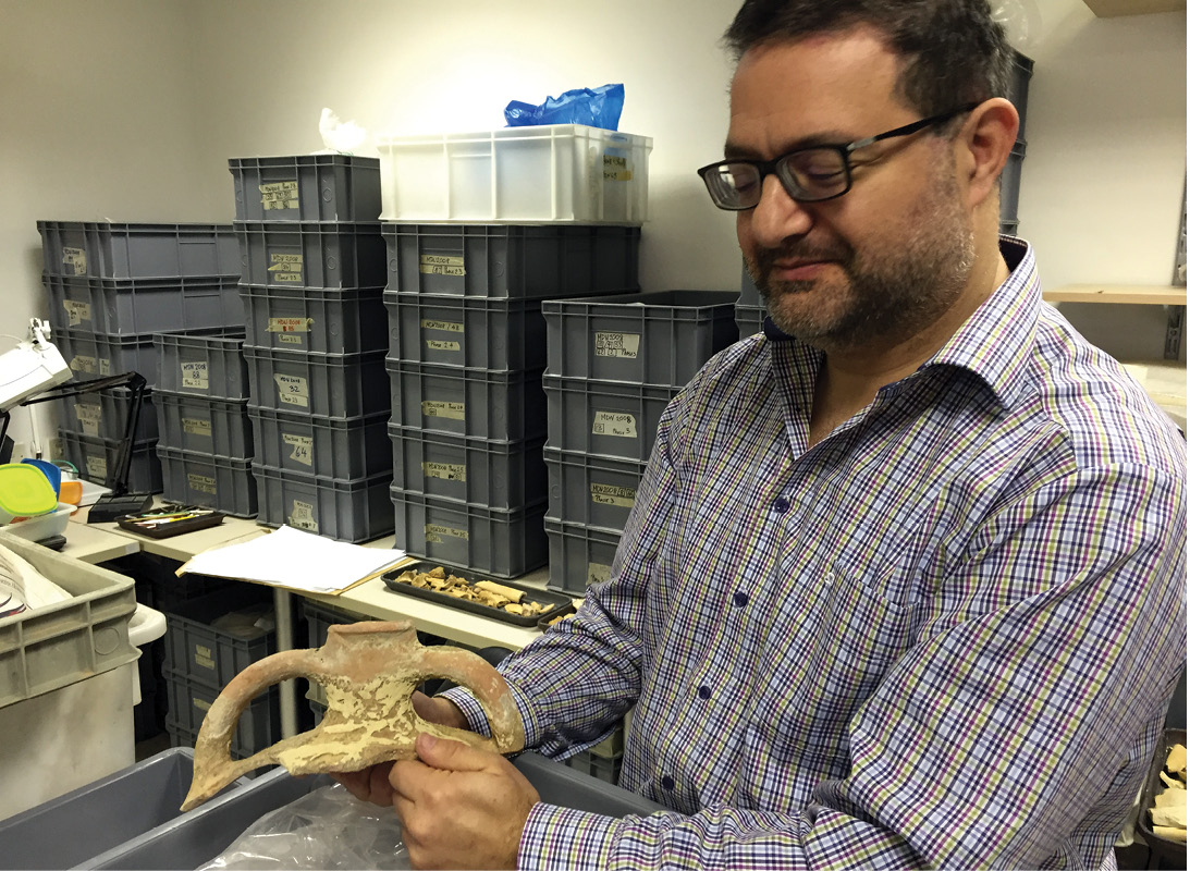 left Well met: Nathaniel Cutujar, Deputy Superintendent with Heritage Malta, has worked on numerous rescue excavations throughout the island; he is shown here with the remains of an imported amphora. below A miniature megalithic sculpture of a resting woman, from the National Archaeology Museum.