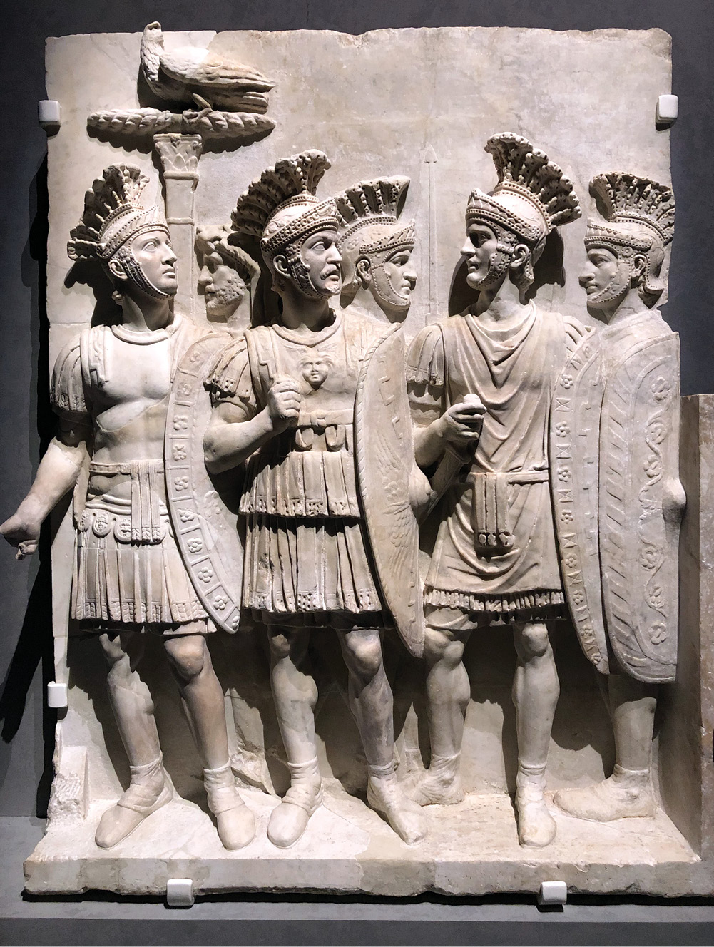 RIGHT The Praetorian Guard, as seen on the triumphal arch commemorating Claudius' invasion of Britain in AD 43. After Claudius' death, these elite soldiers swore allegiance to Nero, but did not intervene to save him in AD 68.