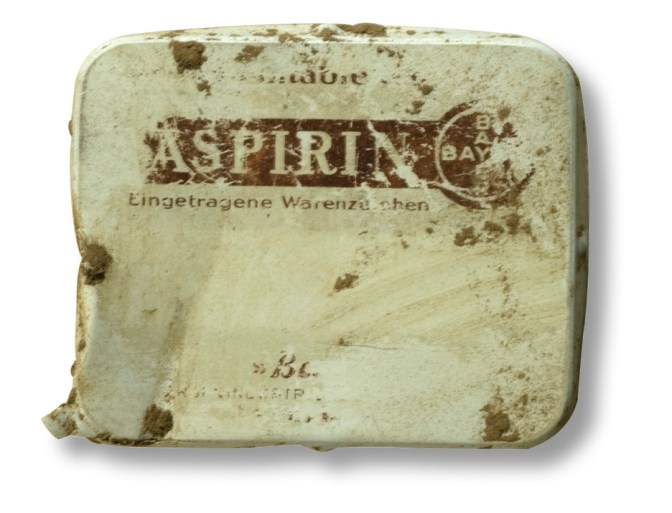 ABOVE A tin that contained asprin. RIGHT This is a stencil that reads: Ein Andenken an die Gefangenschaft 1944/45 Cherbourg, which translates as 'In memory of captivity from 1944 to 1945 Cherbourg'.