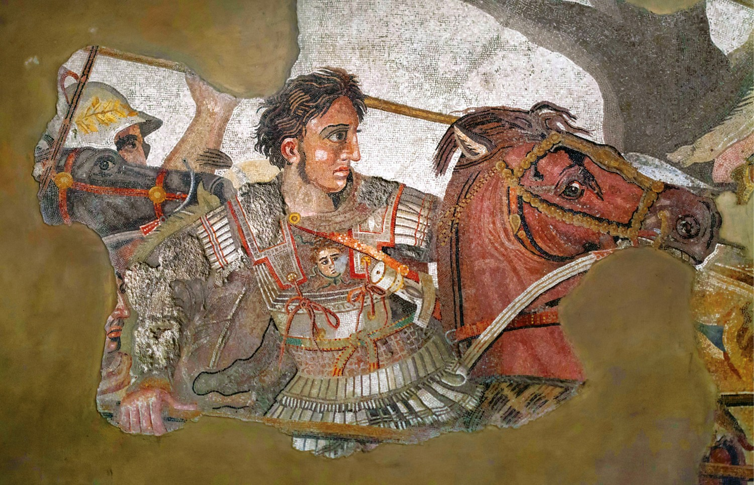 above Portrait of Alexander on the Alexander Mosaic from the House of the Faun at Pompeii. The youthful, clean-cut features, the brushed-back wavy hair, the large eyes, fleshy lips, and bridgeless nose were characteristic of all later portraits of the Macedonian king, who became a role-model for later Hellenistic and Roman rulers.