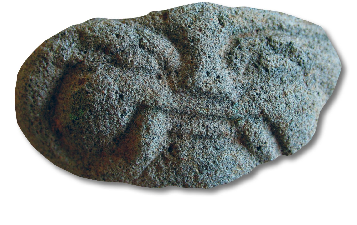 Above A small ornamental mask. Found with the green masks, and made of the same material, this can be dated on stylistic grounds to the 13th or 14th century. Aboveright A length of brick roofing under excavation.