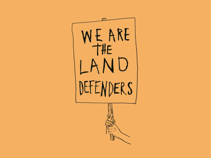 "An illustration in black lines on a yellow background. It shows a hand holding up a sign that says ""WE ARE THE LAND DEFENDERS."""