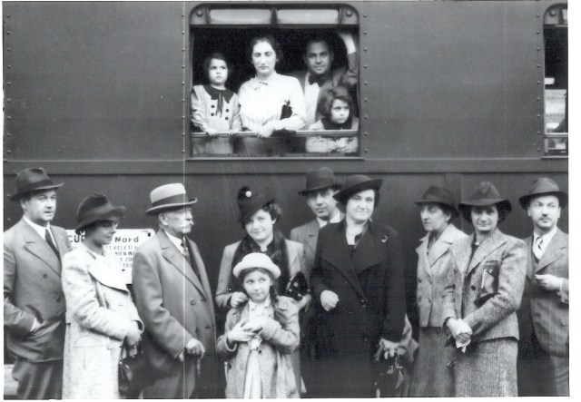 A photograph of a family at Vienna Central Station in 1938.